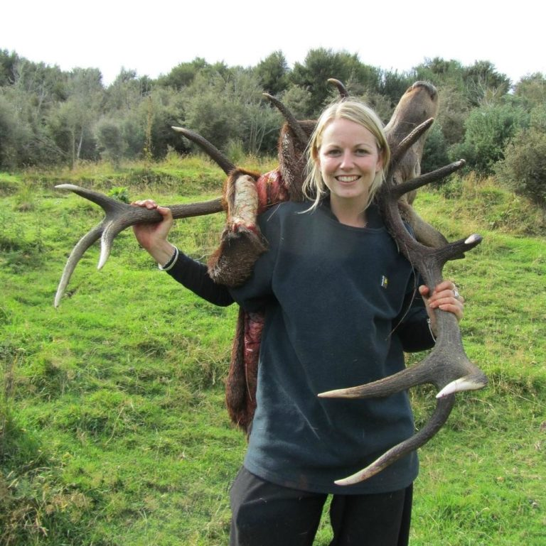 woman with trophy red stag guided hunts NZ South Island